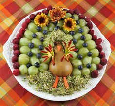 Adorable Turkey Fruit Platter with flower wings and sprout hair! Rattlebridge Farm #thanksgiving