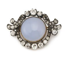 A jewelled gold brooch, August Hollming for Fabergé, St Petersburg, 1899-1908, the cabochon moonstone set within rose-cut diamonds.