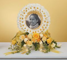 Beautiful wreath of white and peachflowers surround a picture of a loved one. Peach and crème roses adorn the base of the wreath. The perfect flowers to share memories with the ones you love. https://plus.google.com/+HeidiRichards/posts/fTrPryuYhEh