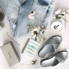 Flatlay flamingo, jeans and notebook