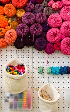 A peg board is a great choice for storing yarn cakes! Get your stash organized!