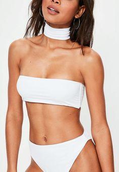 Channel major Kim K vibes with this white choker bikini set.