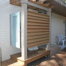 hinge shutters off the side of the house to make little 'walls' when shower is in use | beach house outdoor shower!