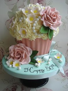 A giant cup-cake idea for a celebration cake decorated with gumpaste flowers Large Cupcake Cakes, Big Cupcake, Giant Cupcakes, Fun Cupcakes, Fancy Cakes, Cupcake Cookies, Ladybug Cupcakes, Kitty Cupcakes, Snowman Cupcakes