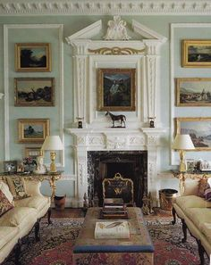Love the robin's egg blue walls, mouldings, millwork, paintings and symmetry