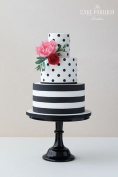 'SIMPLY STRIPES & DOTS' Wedding Cake - Striking and fun black and white stripy and dotty wedding cake decorated with sugar Angelique Tulip and Ranunculus. #weddingcakes