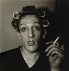 """Review: 'Diane Arbus: American Portraits' at the Heide Museum of Modern Art, Melbourne. """"The power of intention"""" Photo: Diane Arbus (1923-71) 'A young man in curlers at home on West 20th St., N.Y.C. 1966' 1966"""