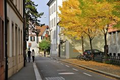 Sometimes we go out of our way to search for beauty. We forget how much of it exists around us. This is a simple photo of a normal street in Basel where the change of seasons added another layer of beauty to an already pleasant street. #autumn #basel #canon #city #leaves #photography #street #switzerland