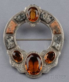 Description:  Large Victorian Silver, Granite, and Citrine Brooch, in the Celtic style, set with cushion-cut citrines, and set with pink and gray granite, engraved accents