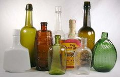 Group of liquor bottles; historical analysis of flasks