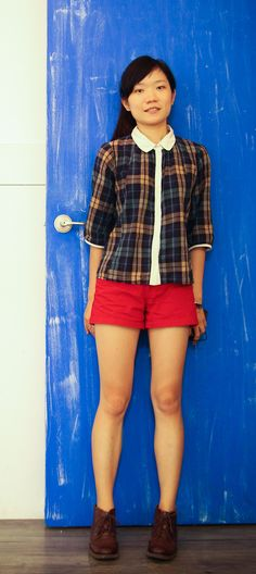 blue plaid with white peter pan collar, red shorts and short boots.