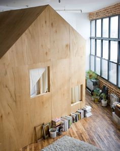 Giant Wooden House Inside a Warehouse with a Window Wall // surreal