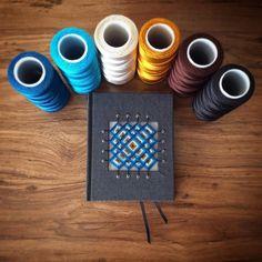 Square back bookbinding with hand sewn mandala cover by Lazaro Mendoza. - Encuadernación de lomo cuadrado, costura de espera, cabezada bordada y mandala bordado en la tapa anterior #bookbinding #encuadernacion #reliure #encadernação #ojodedios #mandalas #reliuredart #handmade #huichol #cuaderno #scketchbook #bookbinder #libretas #notebook #encuadernación #artesanal #bookarts #artisan