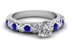 Round Cut Diamond Cross Wedding Band Side Stone Engagement Ring With Blue Sapphire In 14k White Gold