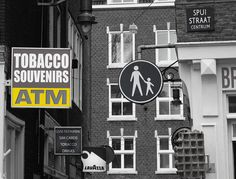 Urban yellow @Amsterdam #urban_yellow #yellow_sign #urbanism #city_centre #yellow #greyscale #Amsterdam #Spuistraat #Korte_Lijnbaanssteeg #blackandwhitephoto #urban_photography #signs #atm