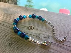 Don't Be Blue With This Lapis Lazuli and Jasper Adjustable Bracelet! Sparkly Jewelry, Crystal Jewelry, Sterling Silver Jewelry, Handmade Bracelets, Handcrafted Jewelry, Art Deco Jewelry, Jewelry Box, Jewelry Making, Lava Bracelet