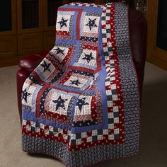 """Waving Old Glory  69"""" x 81""""  Quilt Designed By Toby Lischko  Made By Dolores Keaton and Toby Lischko    Grab a collection of red, white, and blue prints and make this patriotic quilt designed by Toby Lischko."""