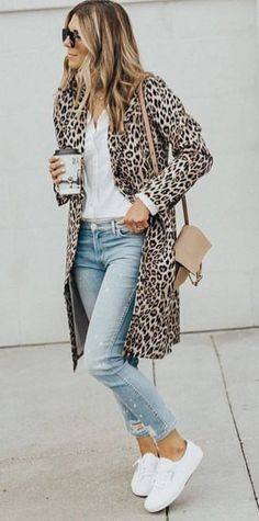 #fall #outfits women's brown-and-black leopard spotted coat; white button up shirt ; blue jeans; pair of white low top sneakers #abrigos