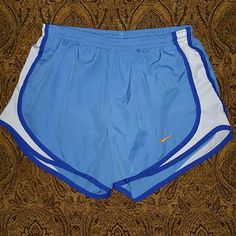Women's SM Nike Tempo Shorts 4-6 Light blue with blue and white trim.  Orange Logo check.  Built in liner.  Good condition. Nike Shorts