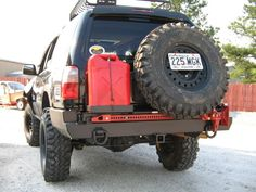 Tire swing arm includes high-lift jack carrier and single gas can carrier. Tactical Truck, Tactical Armor, Toyota Trucks, Lifted Ford Trucks, 4x4 Trucks, 1990 Toyota 4runner, 3rd Gen 4runner, Toyota Girl, Off Road Bumpers