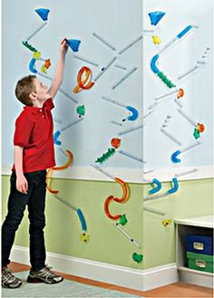 MARBLES!  Rube Goldberg-style marble race that can be placed on a vertical surface.