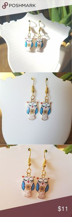Adorable painted owl earrings These are so cute, fashion dangle owl earrings. Uniquely designed  and new without tags. Jewelry Earrings