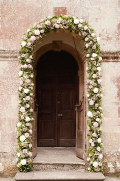 floral garland around door