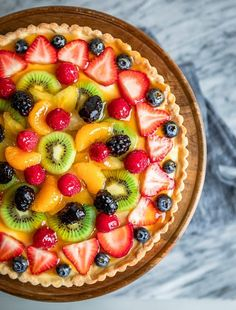 Fresh Fruit Tart - Learning how to make a fruit tart is one of the classic, basic recipes that leads the way into learning how to make other beautiful desserts. Desserts To Make, Köstliche Desserts, Delicious Desserts, Dessert Recipes, Yummy Food, Tasty, Fresh Fruit Tart, Fruit Custard Tart, Pastries