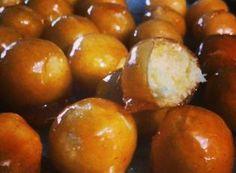 Bala de coco caramelizada (bala baiana ou bala de ovo)