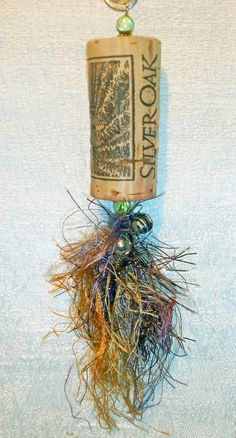 Ever wonder what to do with that cork you saved from that special event or bottle.  Great ornament!