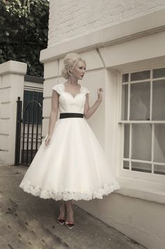 Kathryn - heavy corded lace bodice with a calf length tulle skirt and scallop lace edging. Shown in Dark Ivory with a light ivory overlay and black belt. Many colours available and 4 different lengths