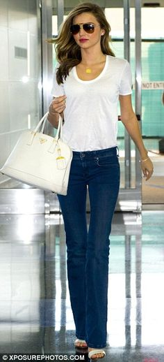 Summer #streetstyle | Miranda Kerr in Isabel Marant white tee, Burberry flared jeans, Gucci sandals and a Prada tote bag
