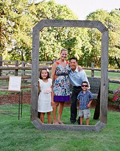 At the photo station, guests frame themselves with the help of an oversized wooden picture frame. These pictures were included in the couple's thank you notes.