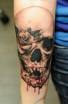 Skull tattoos by John Maxx