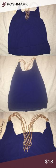 Trendy blue top Brand new with tags! Made in Italy! Absolutely stunning top! Taking offers now!! Must go!! Tops