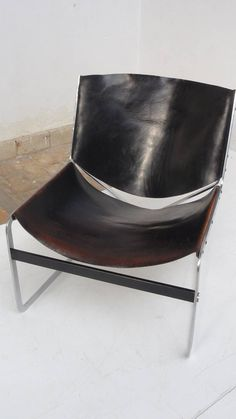Rare PIERRE PAULIN  Lounge Chair for A. Polak Originals, Netherlands, circa 1959 | Original, patinated saddle leather and nickel-plated steel; limited number production; sold via Metz & Co., Amsterdam | ARTbRoKERDeSIgn