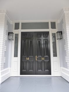 Double front doors in black White trim Narrow lights either side Hamptons style. Double Front Doors, Front Door Entrance, White Trim, Black White, Polished Brass, The Hamptons, Personalized Gifts, Garage Doors, Entryway