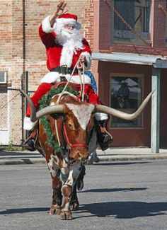 Santa rides in on a longhorn