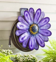 This colorful garden hose storage solution doubles as wall decor. Handmade in Bali, the Daisy Hose Holder mounts to the wall and holds up to standard garden hose. Water Hose Holder, Garden Hose Holder, Purple Daisy, Purple Flowers, Garden Items, Garden Tools, Garden Projects, Spring Garden, Lawn And Garden
