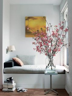 Martha Stewart Living Reading Nook/Remodelista The addition of flowering branches brings nature inside for this window seat inspired reading nook! Decoration Inspiration, Interior Inspiration, Interior Ideas, Decor Ideas, Room Interior, Decorating Ideas, Design Inspiration, Corner Decorating, Summer Decorating