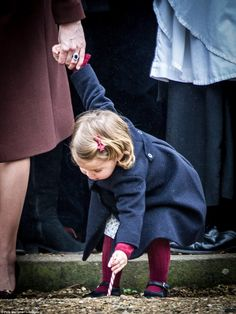 Princess Charlotte was in a playful spirit as she tried to place her candy cane in the gro...