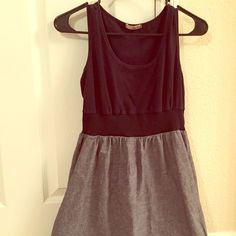 Cotton Black and Grey Dress A lightweight cotton sundress with built in elastic waistband. Size large but fits more like a medium/large. The black is slightly faded but still looks good! BeBop Dresses