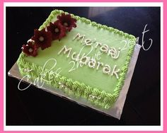 """CAKE TO CELEBRATE """"ME'RAAJ"""". VANILLA FLAVOR BEAUTIFULLY DECORATED WITH BUTTER CREAM AND HANDMADE CHOCOLATE FLOWERS"""