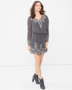 """With a nod to the 70s, our boho dress is all about romantic details, like a feminine front lace-up and floral embroidery. Finish with our gray suede booties for a bit of right now.  Three-quarter sleeve boho embroidered dress in moonwalk Front lace-up and floral embroidered detail Silver embroidery threads Elastic waistline; lined Approx. 36 1/4"""" from shoulder; 2"""" above knee Polyester. Machine wash cold. Imported"""