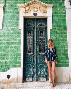 In love with the tiled buildings and rustic doors throughout Lagos  Playsuit from @herempireboutique by tuulavintage