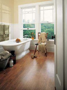Durable laminate flooring is a low-cost option available in styles that mimic stone, tile and hardwood floors.
