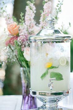 Homemade lemonade in a pretty dispenser: love this idea for a bridal shower.