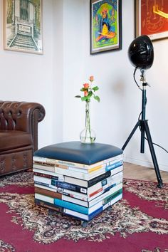 Colorful old books upcycled into a fun and modern ottoman.