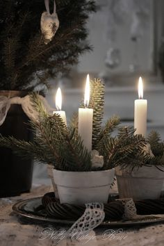 A simple candle decoration for the table - paint a small plant pot white (scrub away some paint with a cloth or sponge) add a few sprigs of conifer or any evergreen tree