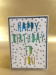 Birthday card using negative alphabet dies. 'Happy birthday to you'.